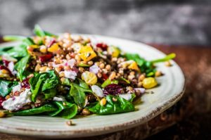 Healthy salad with spinach,quinoa and vegetables