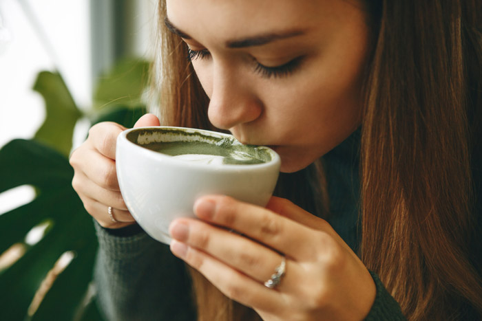 Woman drinking matcha