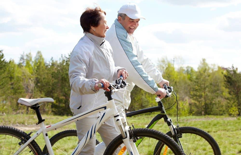 Senior couple going cycling.