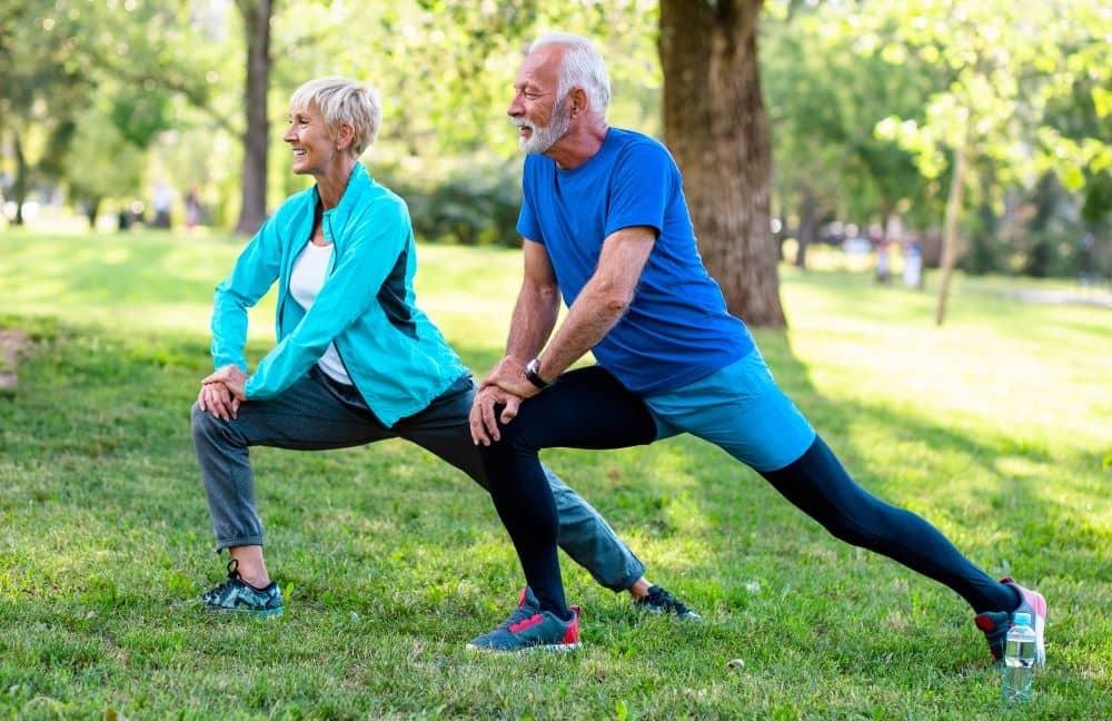 Senior couple doing stretching exercise.